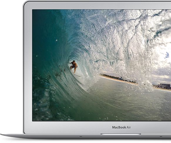 macbook with surfer on screen to demonstrate how a local freelance copywriter can send you surfing towards success